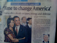 Link to Shane Vigil's photo of newspaper with Obama photo. Used under a Creative Commons license.